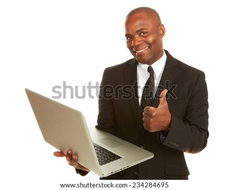 Portrait of happy young businessman with laptop gesturing thumbs up over white background