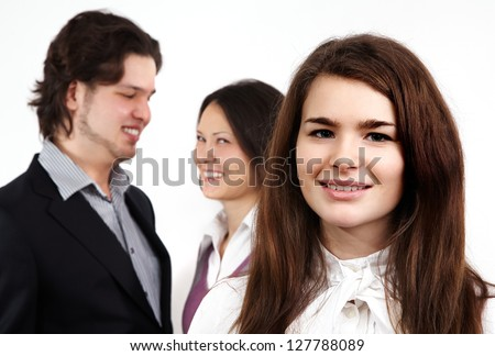 Portrait of happy young businesswoman on background of her colleagues. Leadership concept