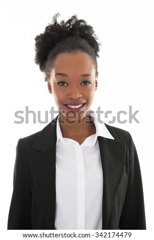 Portrait of happy young businesswoman standing against white background - stock photo