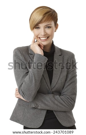 Portrait of happy young businesswoman thinking, smiling. Isolated on white. - stock photo
