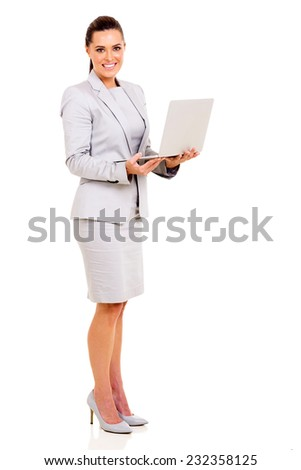portrait of happy young businesswoman with laptop - stock photo