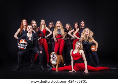 Portrait of happy young cheerleaders indoor -  Concept of unity and team sport - Training at college high school - stock photo