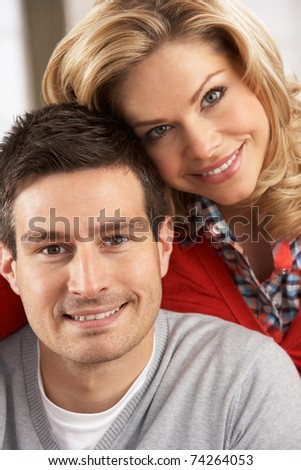 Portrait Of Happy Young Couple At Home - stock photo