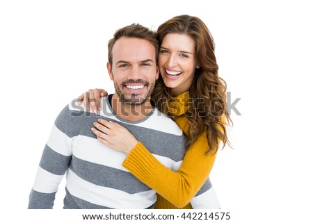 Portrait of happy young couple embracing each other on white background - stock photo