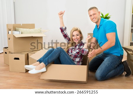 Portrait Of Happy Young Couple Enjoying In Their New Home