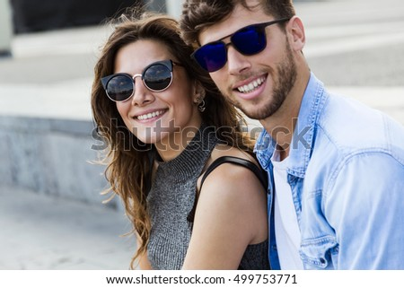 Portrait of happy young couple in love in the city.