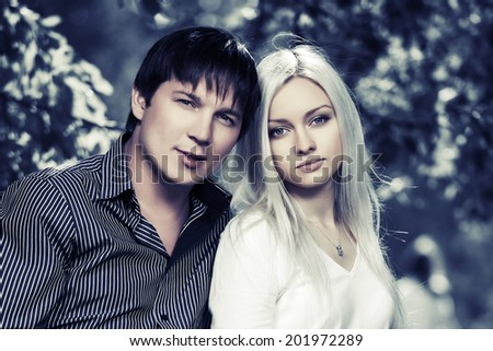 Portrait of happy young couple in love outdoor - stock photo