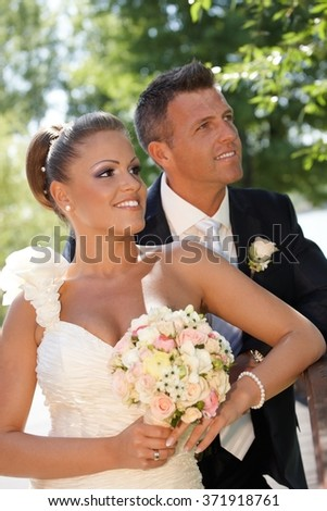 Portrait of happy young couple on wedding-day. Outdoor photo. - stock photo