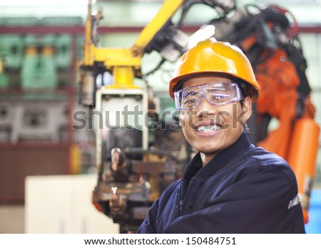 Portrait of happy young engineer - stock photo