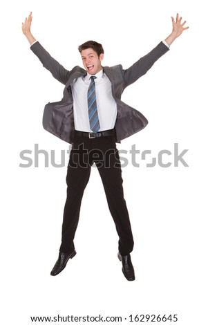 Portrait Of Happy Young Excited Businessman Over White Background