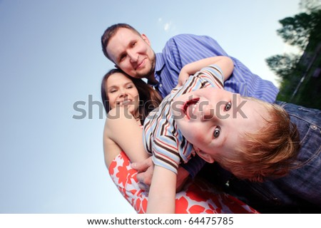 portrait of happy young family - stock photo