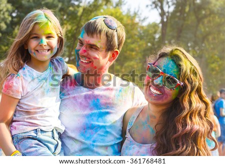 Portrait of happy young family on holi color festival