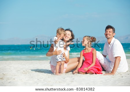 Portrait of happy young family on tropical vacation - stock photo