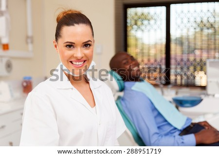 portrait of happy young female dentist  - stock photo