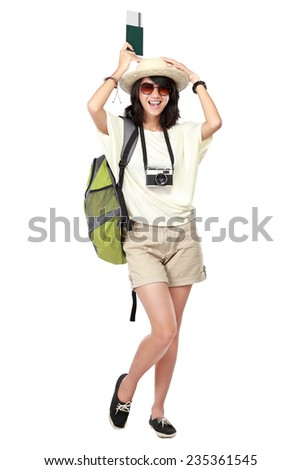 portrait of happy young girl bring backpack and passport
