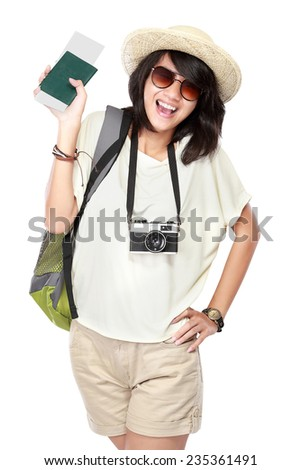 portrait of happy young girl bring backpack, boarding pass and passport