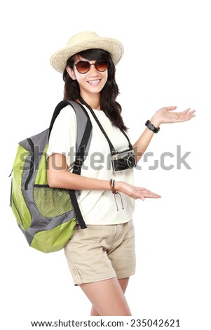 portrait of happy young girl bring backpack pointing blank space