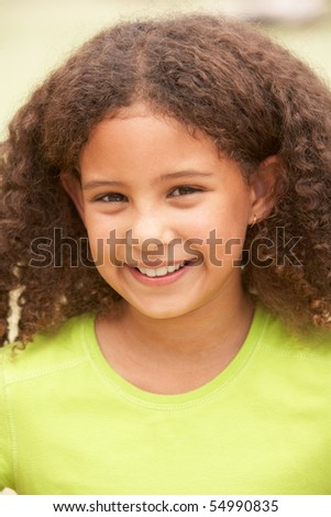 Portrait Of Happy Young Girl In Park - stock photo