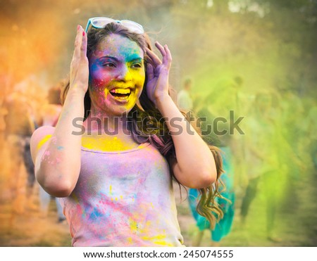 Portrait of happy young girl on holi color festival - stock photo