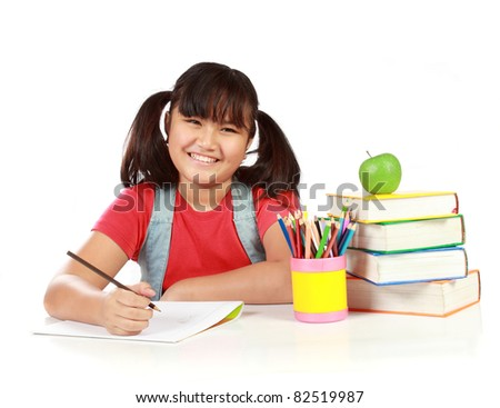 portrait of happy young girl studying. isolated over white background - stock photo