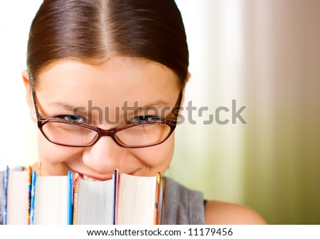 Portrait of happy young girl when working 4 - stock photo