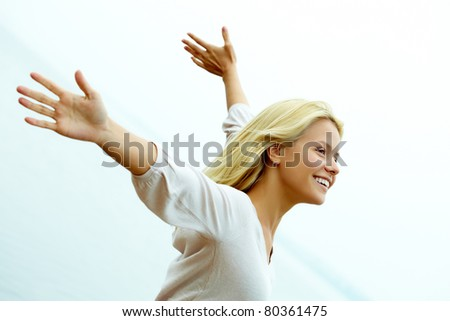 Portrait of happy young girl with stretched arms enjoying life - stock photo