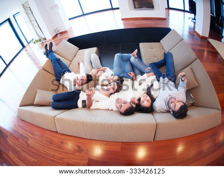 portrait of happy young group of friends get releax and have fun at modern home interior, top view - stock photo