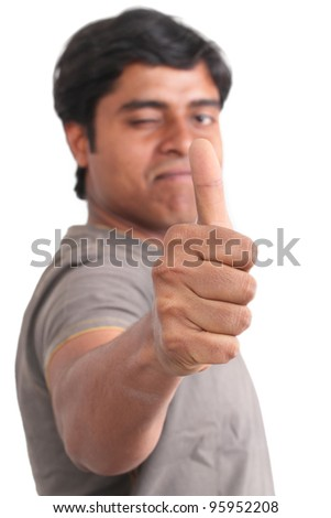 Portrait of happy young indian giving thumbs up over white background - stock photo