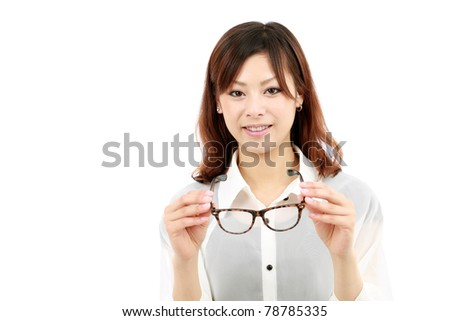 Portrait of happy young japanese woman with glasses - stock photo