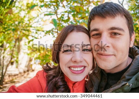 Portrait of happy young loving couple making selfie