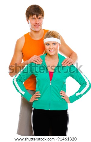 Portrait of happy young man and fitness girl in sportswear isolated on white - stock photo