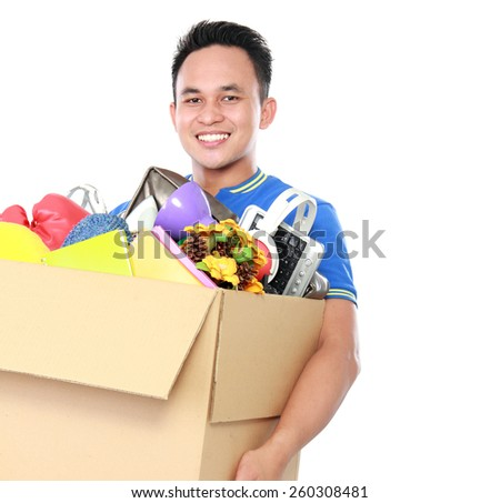 portrait of happy young man carrying box full of stuff on white background - stock photo