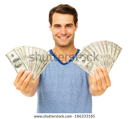 Portrait of happy young man holding fanned US paper currency over white background. Horizontal shot. - stock photo