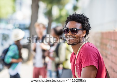 Portrait of happy young man in sunglasses - stock photo