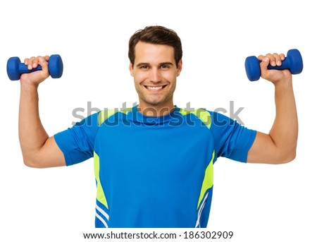 Portrait of happy young man lifting weights over white background. Horizontal shot.