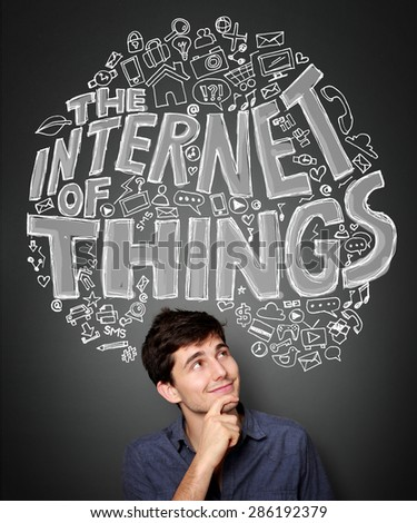 portrait of Happy young man looking up to The concept of internet of things - stock photo