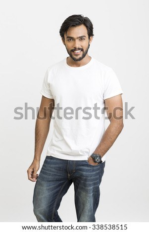 Portrait of happy young man on grey background - stock photo
