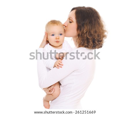 Portrait of happy young mom kissing her baby - stock photo