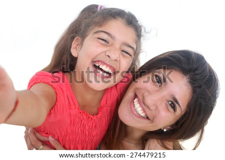portrait of happy young mother and her daughter taking self portrait on a white background - stock photo