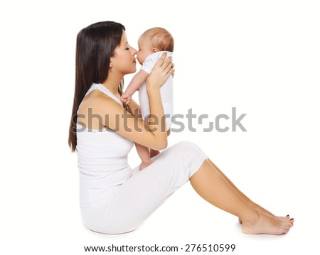 Portrait of happy young mother kissing cute baby  - stock photo