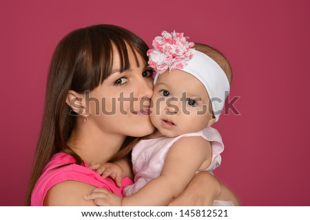 portrait of happy young mother with her little daughter - stock photo