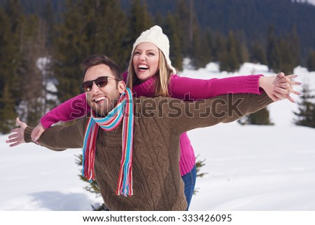 portrait of happy young romantic tourist  couple outdoor in nature at winter vacation - stock photo
