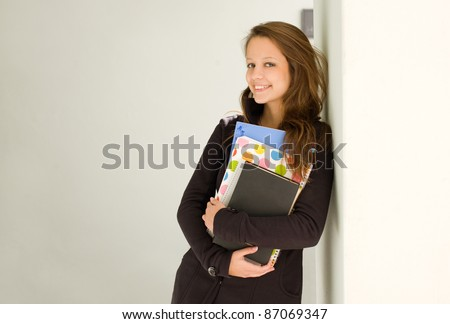 Portrait of happy young student girl. - stock photo