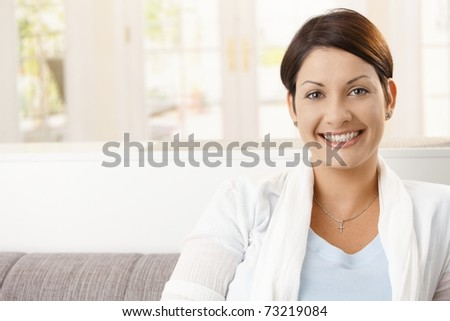 Portrait of happy young woman at home, smiling.?