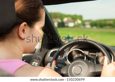 Portrait Of Happy Young Woman Driving The Car - stock photo