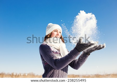 Portrait of happy young woman have fun at beautiful sunny winter day  - stock photo