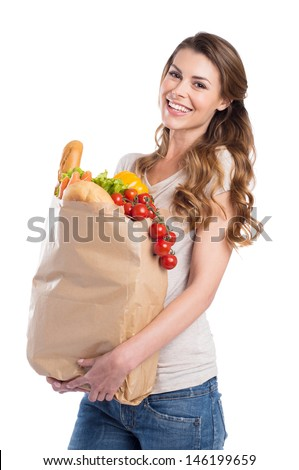 Portrait Of Happy Young Woman Holding Grocery Bag Over White Background - stock photo