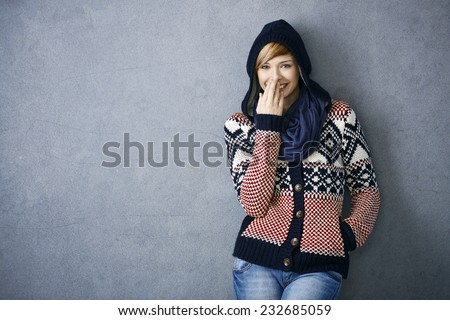 Portrait of happy young woman in scandinavian sweater, laughing - stock photo