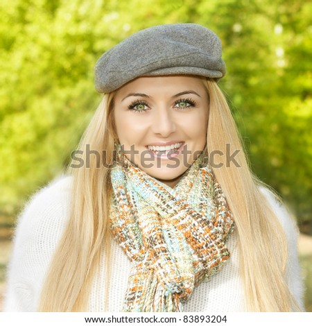Portrait of happy young woman outdoors. - stock photo