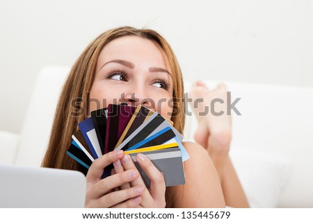 Portrait Of Happy Young Woman Shopping With Credit Card - stock photo